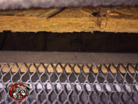 There is a gap of about an inch between the roof sheathing and the fascia board