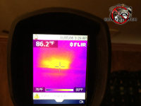 Infrared camera locating a honey bee nest in the ceiling of a house