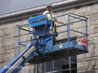 Man on a lift truck performing bird control in Moody, Alabama