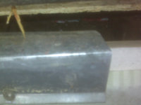 Shoddy animal damage repair with roof flashing