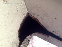 A flying squirrel hole in the exterior wall of a home in Pell City, AL