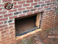 The foundation vent cover is missing from a house in Gainesville Georgia and the raccoons got into the house through the opening