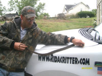 Snake removal expert with red-bellied water snake in Mountain Brook, AL