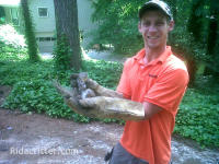 Squirrel trapper holding squirrels he removed from a home in Homewood, Alabama