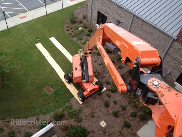 Looking down at a lift truck from the elevated platform