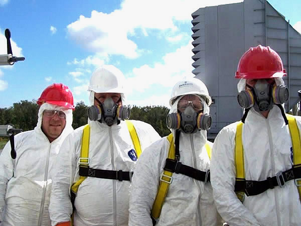 Four men in protective gear waiting to start a bird control job in Georgia